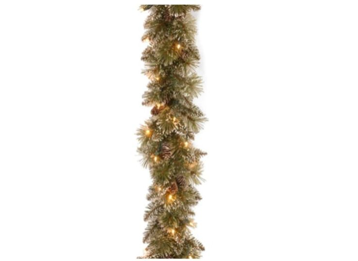 1.THE 9-FOOT PRE-LIT SNOW-COVERED CHRISTMAS TREE